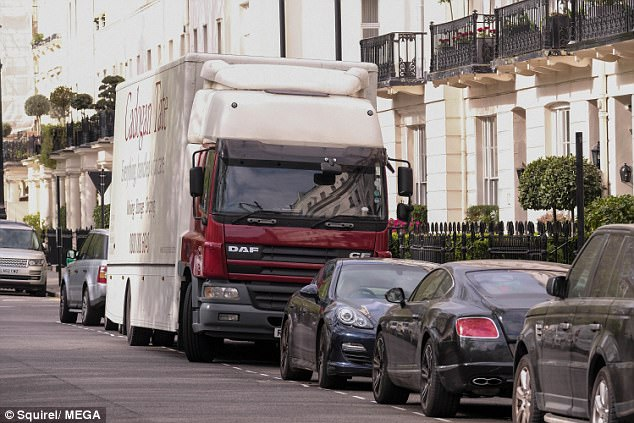 3F2EA9C500000578-4404826-They_mean_business_A_giant_lorry_was_pictured_outside_of_the_pro-a-1_1491997446313